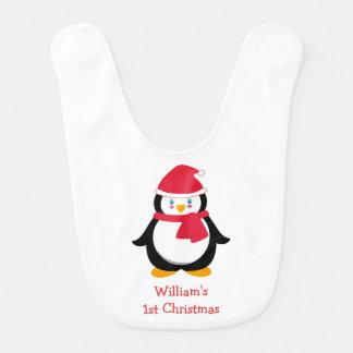 1r babero del navidad del bebé con el pingüino