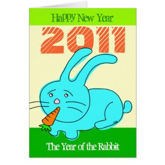 2011 años de conejo de la tarjeta del conejo comen