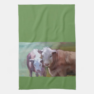 2 vacas en una toalla de cocina del paisaje