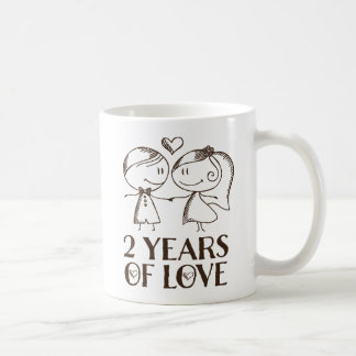 2do La mano del aniversario dibujada junta la taza
