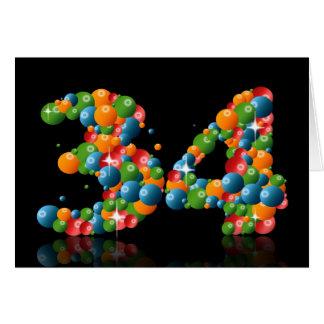 34to cumpleaños con los números formados de bolas tarjeton