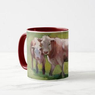 3 vacas en un paisaje taza