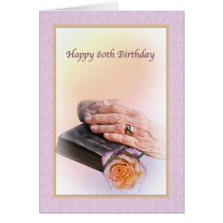 80 o Tarjeta de cumpleaños con las manos y la bibl