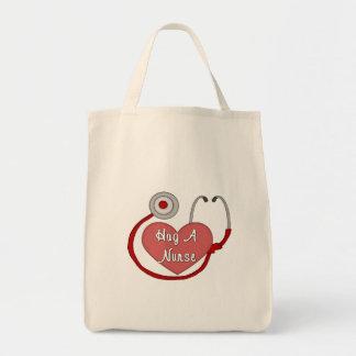 Abrace a una enfermera bolsa tela para la compra