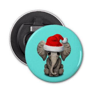 Abrebotellas Elefante del bebé que lleva un gorra de Santa