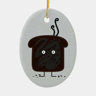 Adorno De Cerámica El humo quemado de la tostada desmenuza el pan de