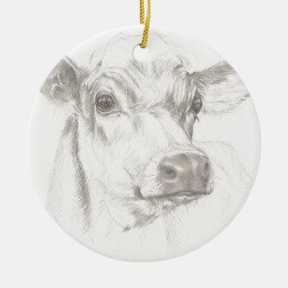 Adorno De Cerámica Un dibujo de una vaca joven