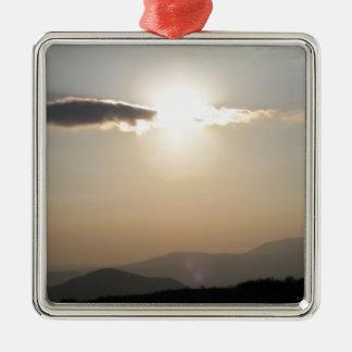 Adorno Metálico Puesta del sol sobre las montañas