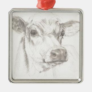 Adorno Metálico Un dibujo de una vaca joven