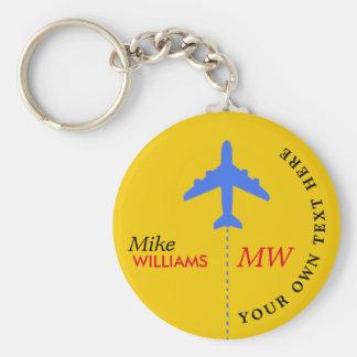 aeroplano en llavero amarillo con nombre