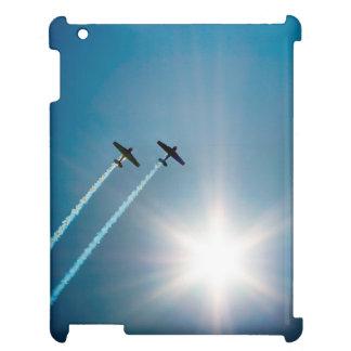 Aeroplanos que vuelan en el cielo azul con Sun.
