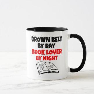 Aficionado a los libros de la correa de Brown Taza