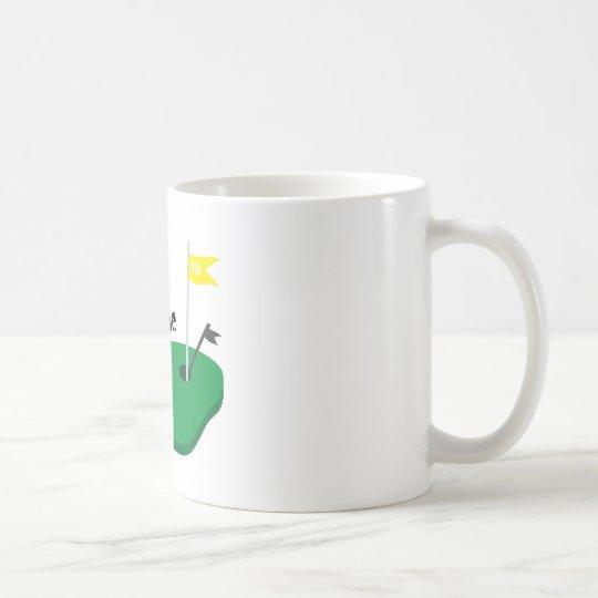 Agujero en uno taza de café