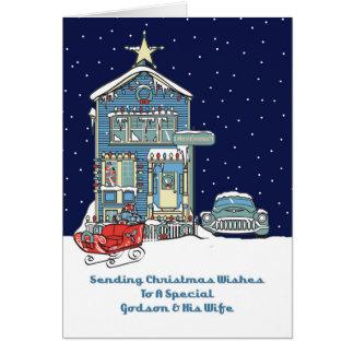 Ahijado y su esposa que envían deseos del navidad tarjeta de felicitación
