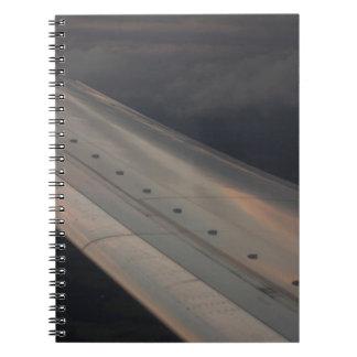 Airplane flying in sky wing in flight photo libretas