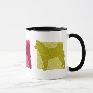 Akita colorido siluetea la taza