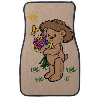 Alfombrilla Para Coche Oso de peluche de Brown que sostiene las flores
