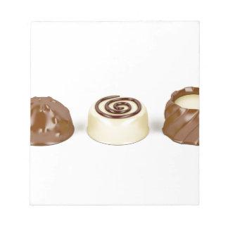 Almendras garapiñadas del chocolate bloc de notas