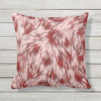 Almohada abstracta roja y rosada hermosa del