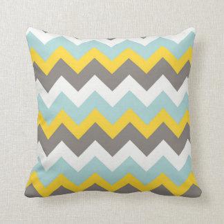 Almohada azul, amarilla, gris, blanca del zigzag