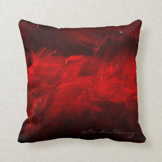 Almohada decorativa de color rojo oscuro