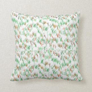Almohada del diseño de la hierba verde