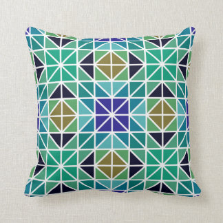 Almohada geométrica azul, verde y negra del mar