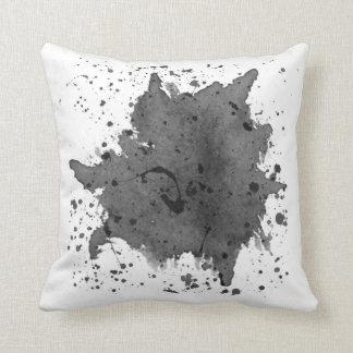 Almohada negra de la salpicadura