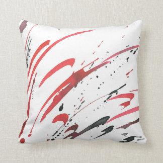 Almohada negra gris roja del extracto de la
