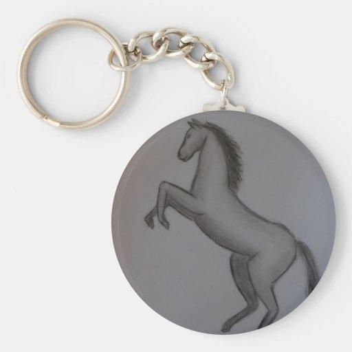 alzar el caballo llaveros