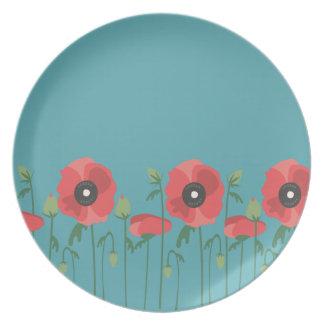 Amapolas florecientes de la primavera platos