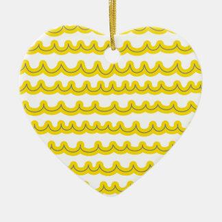 Amarillo caprichoso de las olas oceánicas adorno de cerámica