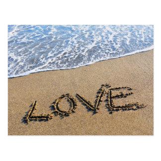 Ame en la postal escrita arena