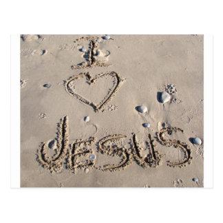 Amo a Jesús escrito en arena Postal