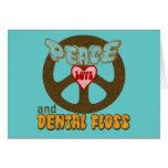 Amor de la paz y seda dental tarjeta