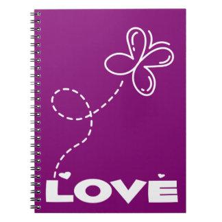 Amor púrpura y blanco de la mariposa y de los libretas espirales