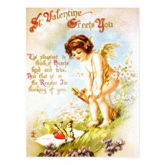 Ángel del Cupid de la letra de amor de la postal