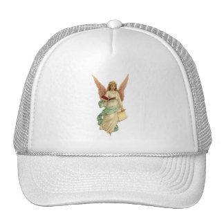 Ángel del navidad del vintage con el libro gorra