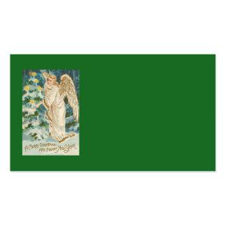 Ángel que enciende el árbol de navidad iluminado tarjetas de visita