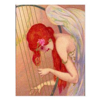 Ángel Redheaded antiguo dulce en la postal de la