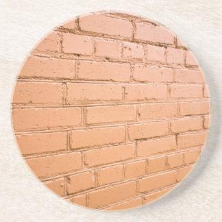Ángulo de visión en la pared de ladrillo posavasos de arenisca