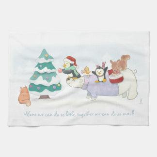 Animales lindos del navidad que adornan un árbol paño de cocina