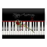 Aniversario subió en piano tarjeta de felicitación