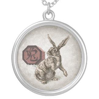Año del arte chino del zodiaco del conejo colgante redondo