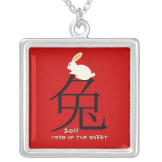 Año del colgante chino de la plata del Año Nuevo