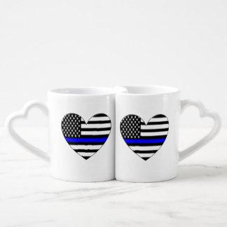 Apoye las tazas de la policía