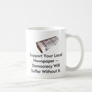 Apoye su diario local… taza de café