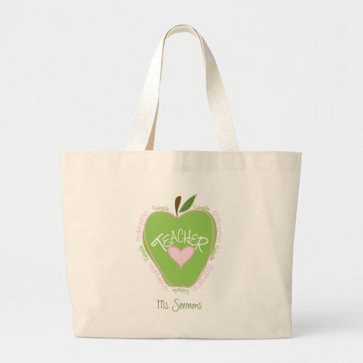Apple rosado y verde del maestro de jardín de infa bolsas de mano