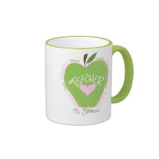 Apple rosado y verde del maestro de jardín de infa tazas de café