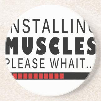 Aptitud y músculos del gimnasio apoyavasos